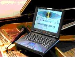 tuning a piano with a laptop